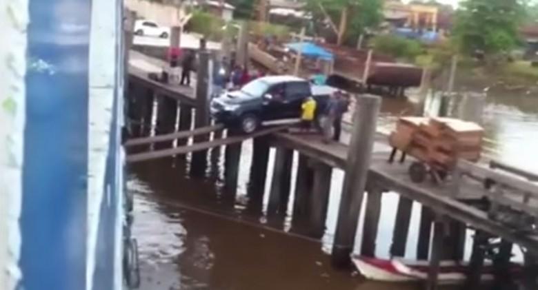 truck drives onto ship