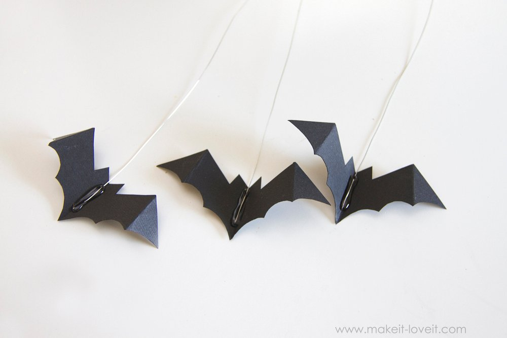 DIY Pumpkins with Hanging and Flying Bats...great autumn decor!   via Make It and Love It